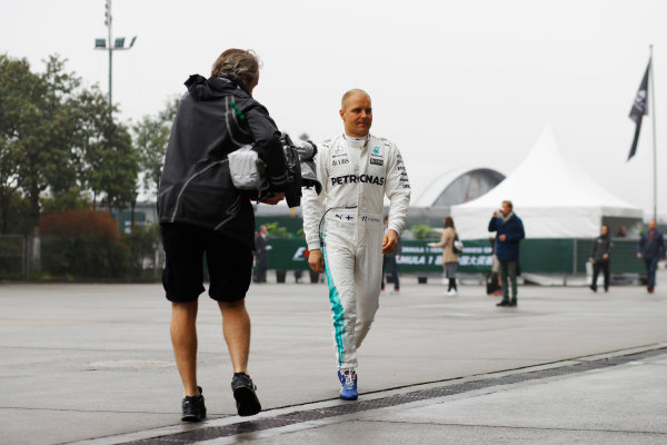 Shanghai International Circuit, Shanghai, China.  Friday 07 April 2017. Valtteri Bottas, Mercedes AMG, is filmed arriving in the paddock. World Copyright: Steven Tee/LAT Images ref: Digital Image _R3I1605
