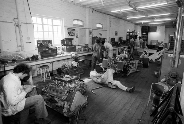 The Copersucar Fittipaldi team work on building the FD04 at the team headquarters.