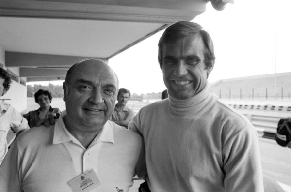 (L to R): 1950s Ferrari F1 driver Froilan Gonzalez (ARG) with Carlos Reutemann (ARG) Ferrari, who finished his home GP in third position.Argentinean Grand Prix, Rd1, Buenos Aires, Argentina, 9 January 1977.