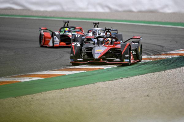 Sebastien Buemi (CHE), Nissan e.Dams, Nissan IMO2, leads Nyck de Vries (NLD), Mercedes Benz EQ, EQ Silver Arrow 02, and Lucas Di Grassi (BRA), Audi Sport ABT Schaeffler, Audi e-tron FE07