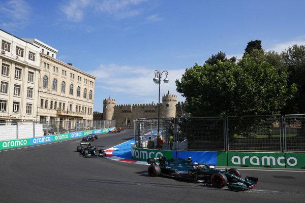 Sebastian Vettel, Aston Martin AMR21, leads Valtteri Bottas, Mercedes W12, and Esteban Ocon, Alpine A521