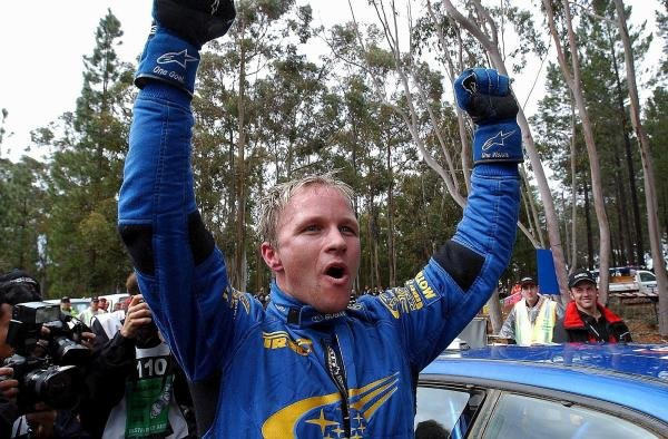 Rally winner Petter Solberg (NOR) Subaru celebrates victory at the end of the final stage.