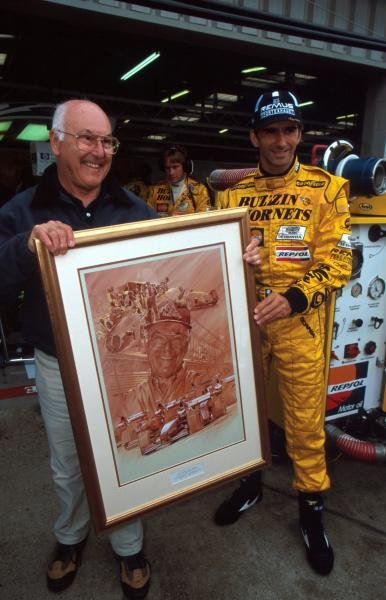 ITV F1 TV commentator Murray Walker (GBR) (left) is presented by Damon Hill (GBR) with a painting commemorating his fifty years of service to British Motorsport.
