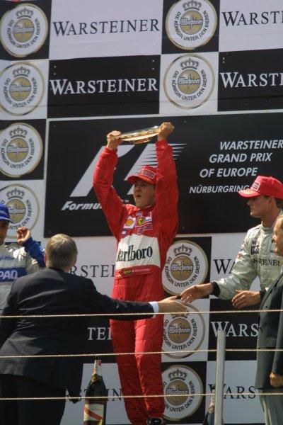 2001 European Grand Prix. RACENurburgring, Germany. 24th June 2001Michael Schumacher, Ferrari F2001, raises his trophy alfot after victory in the European gran prix.World Copyright - LAT Photographicref: 8 9 MB Digital File Only