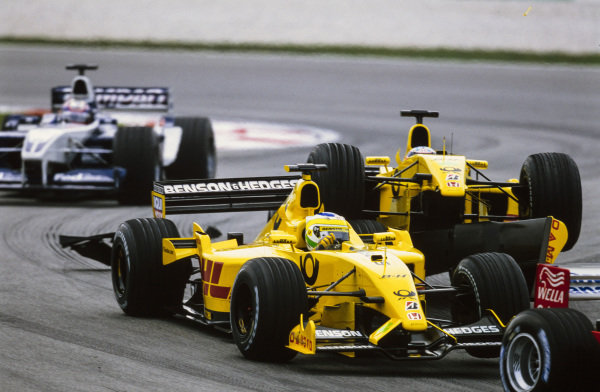 Takuma Sato, Jordan EJ12 Honda, mounts Giancarlo Fisichella, Jordan EJ12 Honda, damaging both.