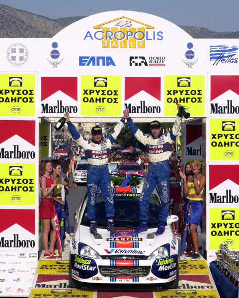 2001 World Rally Championship.Acropolis Rally June 14-17, 2001.Colin McRae & Nicky Grist celebrate their third successive victory.Photo: Ralph Hardwick/LAT