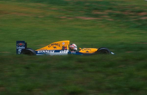 1992 Brazilian Grand Prix.Interlagos, Sao Paulo, Brazil.3-5 April 1992.Nigel Mansell (Williams FW14B Renault) 1st position.Ref-92 BRA 13.World Copyright - LAT Photographic