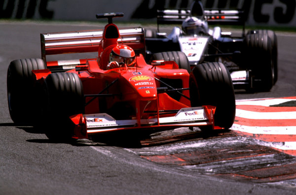 French Grand Prix.Magny-Cours, France. 30/6-2/7 2000.Michael Schumacher (Ferrari F1-2000) followed by David Coulthard (McLaren MP4/15 Mercedes).World Copyright - Steven Tee/LAT PhotographicFormat: 35mm transparenc