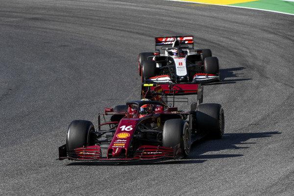 Charles Leclerc, Ferrari SF1000, leads Romain Grosjean, Haas VF-20