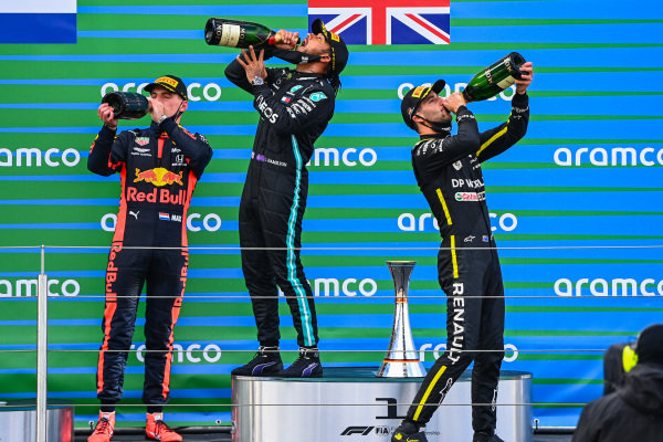 Max Verstappen, Red Bull Racing, 2nd position, Lewis Hamilton, Mercedes-AMG Petronas F1, 1st position, and Daniel Ricciardo, Renault F1, 3rd position, drink Champagne on the podium