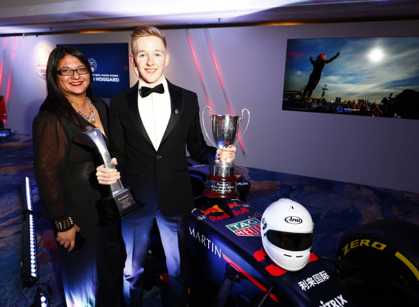 Aston Martin Autosport BRDC Young Driver Award winner Johnathan Hoggard with his trophy and cheque stands with the Red Bull Racing RB15 with  Sunita Davies.