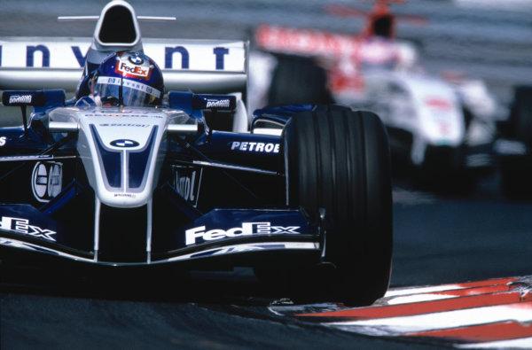 2004 Hungarian Grand Prix Hungaroring, Hungary. 13th - 15th August. Juan Pablo Montoya, WilliamsF1 BMW FW26 leads Jenson Button, BAR Honda 006. Action. World Copyright:Michael Cooper/LAT Photographic Ref:35mm Image:A11
