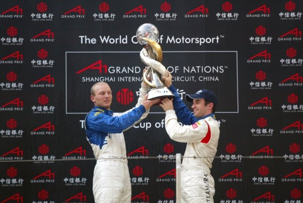 Alexandre Premat (FRA) A1 Team France and Nicolas Lapierre (FRA) A1 Team France lift the World Cup of Motorsport on the podium. A1 Grand Prix, Rd11, Race Day, Shanghai, China, 2 April 2006. DIGITAL IMAGE