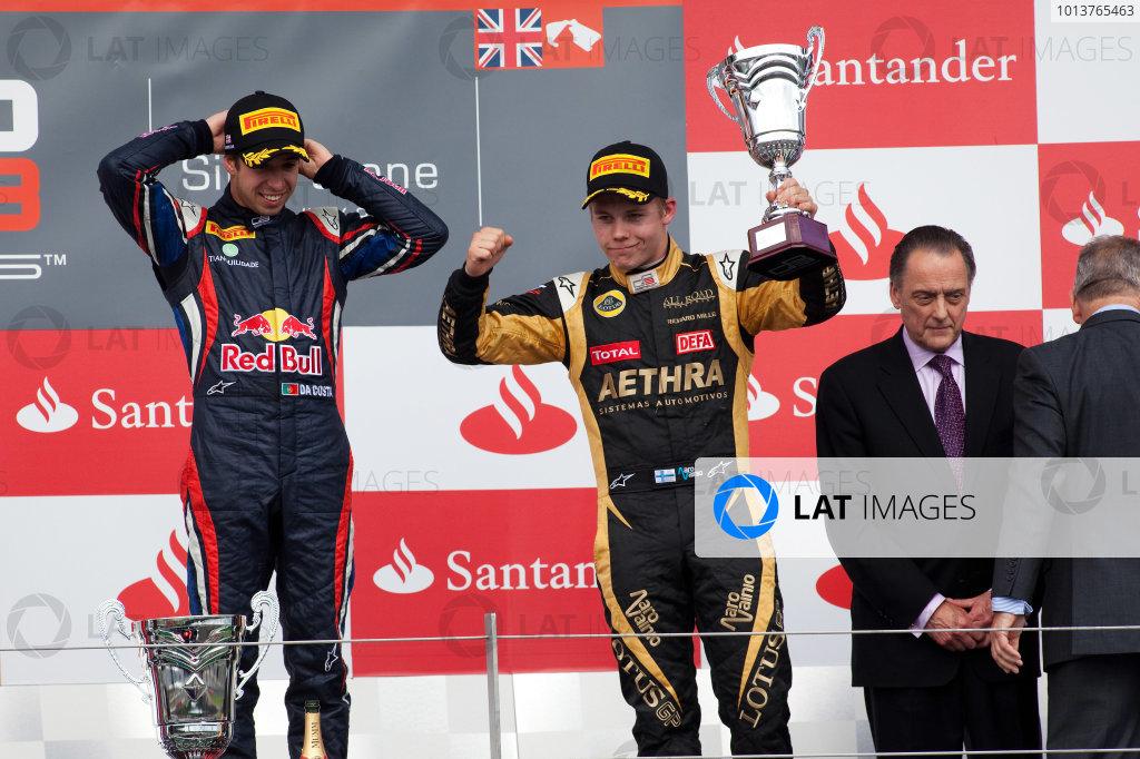 Silverstone, Northamptonshire, England. 7th July 2012. Saturday Race 1. Aaro Vainio (FIN, Lotus GP) celebrates on the podium. Portrait. World Copyright:  Daniel Kalisz/LAT Photographic Ref: Digital Image IMG_5945.jpg