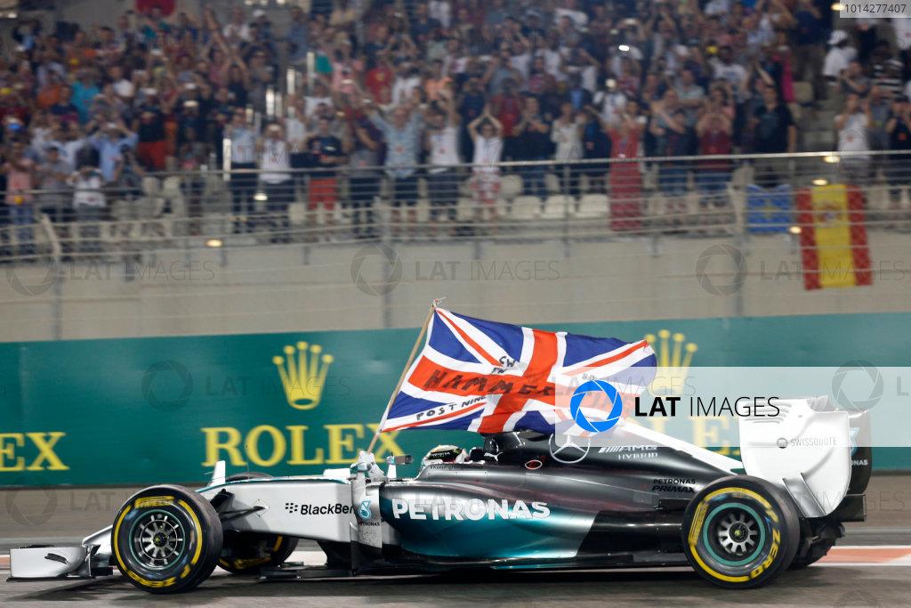 Yas Marina Circuit, Abu Dhabi, United Arab Emirates. Sunday 23 November 2014. Lewis Hamilton, Mercedes F1 W05 Hybrid, celebrates after winning the race and the 2014 Drivers Championship. World Copyright: Alastair Staley/LAT Photographic. ref: Digital Image _79P0850