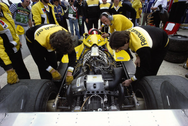 Mechanics check the turbocharged engine in Jean-Pierre Jabouille's Renault RS01 ahead of their debut.