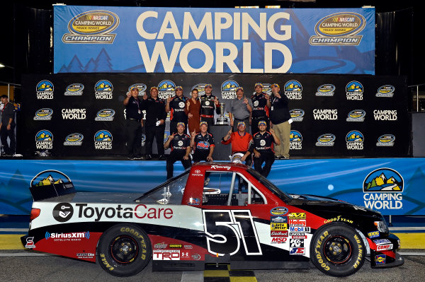 November 15, 2013, Homestead, Florida USA Kyle Busch celebrates the Camping World Truck Series Owners Champion award with his team. © 2013, Brian Czobat LAT Photo USA