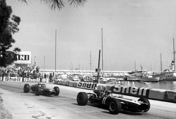 1967 Monaco Grand Prix Monte Carlo, Monaco. 7 May 1967 Pedro Rodriguez, Cooper T81-Maserati, 5th position, leads Piers Courage, BRM P261, retired, action World Copyright: LAT PhotographicRef: Motor b&w print