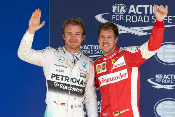 Interlagos, Sao Paulo, Brazil. Saturday 14 November 2015. Pole man Nico Rosberg, Mercedes AMG, with Sebastian Vettel, Ferrari, 3rd on the grid. World Copyright: Steve Etherington/LAT Photographic ref: Digital Image SNE12393