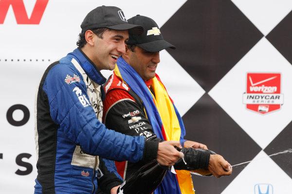 27-29 June, 2014, Houston, Texas USA Carlos Huertas and Juan Pablo Montoya celebrate with champagne ©2014, Phillip Abbott LAT Photo USA