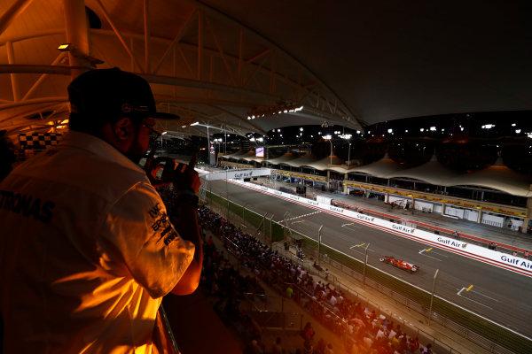 Bahrain International Circuit, Sakhir, Bahrain.  Sunday 16 April 2017. A fan watches Kimi Raikkonen, Ferrari SF70H, from the grandstand. World Copyright: Sam Bloxham/LAT Images ref: Digital Image _J6I2169