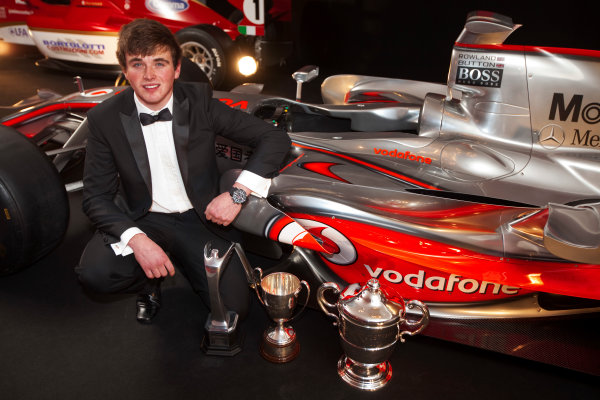 Grosvenor House Hotel, Park Lane, London 4th December 2011 McLaren Autosport BRDC Young Driver of the Year Award winner Oliver Rowland poses with the McLaren Mercedes F1 display car.World Copyright: Glenn Dunbar/LAT Photographic ref: Digtal Image GD5D0426