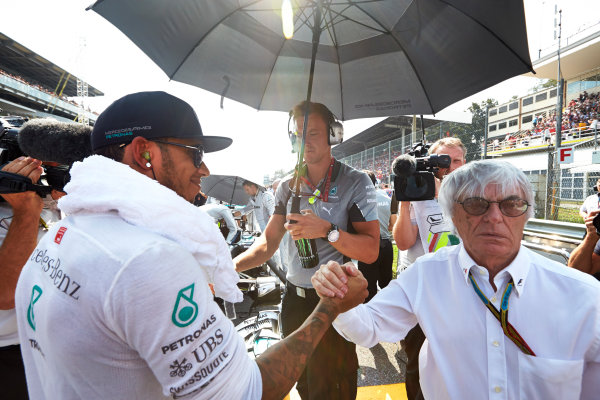 Autodromo Nazionale di Monza, Monza, Italy. Sunday 7 September 2014. Lewis Hamilton, Mercedes AMG, on the grid with Bernie Ecclestone, CEO and President, FOM. World Copyright: Steve Etherington/LAT Photographic. ref: Digital Image SNE27879