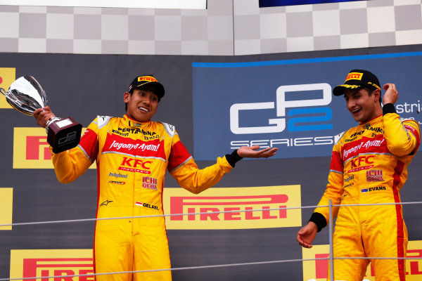 2016 GP2 Series Round 4 Red Bull Ring, Spielberg, Austria Saturday 2 July 2016 Mitch Evans (NZL, Pertamina Campos Racing) celebrates with Sean Gelael (INA, Pertamina Campos Racing) on the podium. Photo: Sam Bloxham/GP2 Series Media Service ref: Digital Image _SBB7512