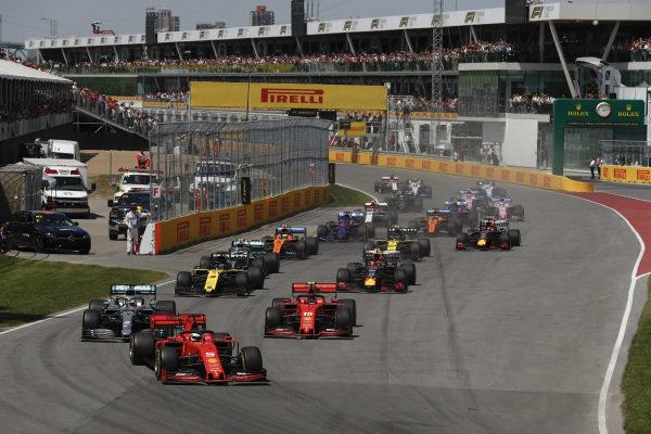 Sebastian Vettel, Ferrari SF90, leads Lewis Hamilton, Mercedes AMG F1 W10, Charles Leclerc, Ferrari SF90, Daniel Ricciardo, Renault R.S.19, Pierre Gasly, Red Bull Racing RB15, and the rest of the filed at the start