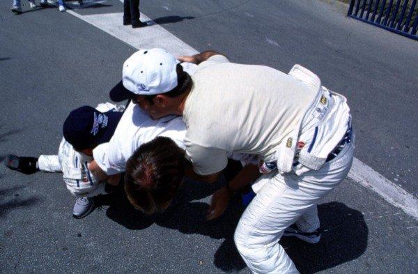 "1999 Spanish Grand Prix.Catalunya, Barcelona, Spain.28-30 May 1999.Stewart Ford team mates Johnny Herbert and Rubens Barrichello ""attack"" Ford Motorsport boss Martin Whitaker.World Copyright - LAT Photographic"