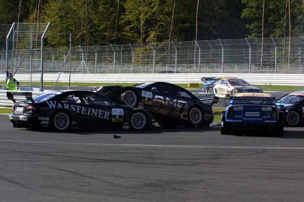 2002 DTM Championship.Hockenheim, Germany. 5-6 October 2002.Jean Alesi's HWA/Mercedes CLK DTM gets airborn as he collides with Marcel Fassler (HWA/Mercedes CLK DTM) as Johnny Cecotto (Euroteam/Opel Astra V8 Coupe DTM) comes sliding in, after being hit seconds earlier.World Copyright - Andre Irlmeier/LAT PhotographicSpitzkehre sequence - 6.