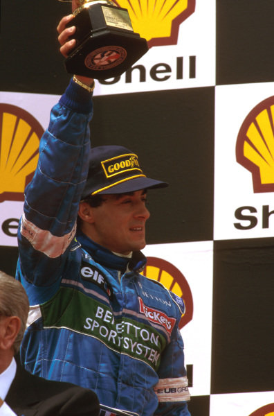 Magny-Cours, France.28-30 June 1996.Jean Alesi (Benetton Renault) 3rd position on the podium.Ref-96 FRA 03.World Copyright - LAT Photographic