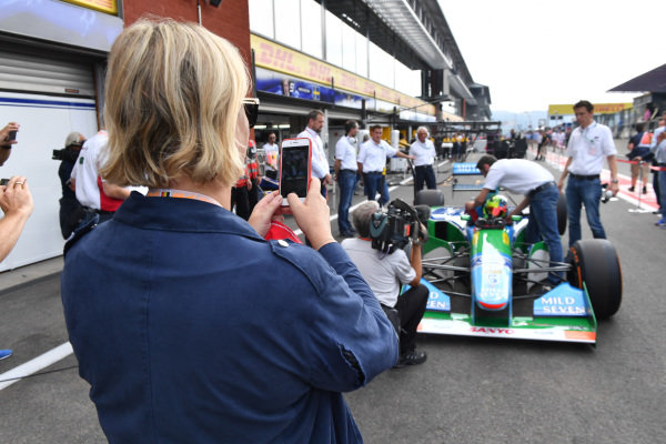Sabine Kehm (GER) takes a photo of Mick Schumacher (GER) Benetton B194 at Formula One World Championship, Rd12, Belgian Grand Prix, Race, Spa Francorchamps, Belgium, Sunday 27 August 2017.