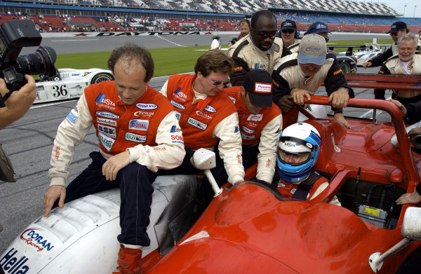 Mauro Baldi, Didier Theys and Max Papis jump upon the fender of their winning car as Fredy Lienhard drives to Victory Lane.