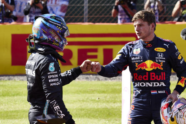 Sir Lewis Hamilton, Mercedes, 2nd position, and Max Verstappen, Red Bull Racing, 1st position, congratulate each other after the Sprint Qualifying race