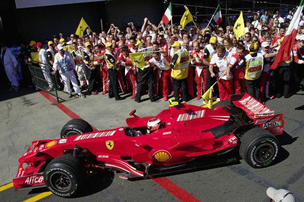Kimi Räikkönen rolls his Ferrari F2007 into parc fermé to the applause and celebrations of his team.