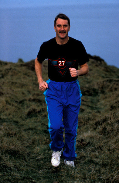 Isle of Man, United Kingdon. 18/4/1989. Nigel Mansell jogs in the countryside