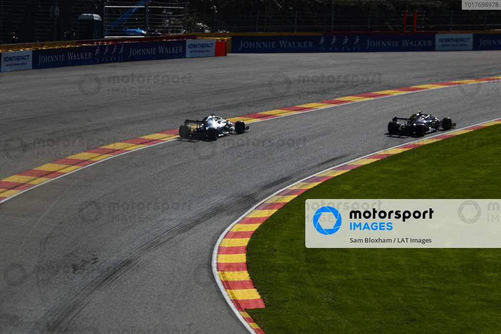 Lewis Hamilton, Mercedes AMG F1 W10, chases Kevin Magnussen, Haas VF-19