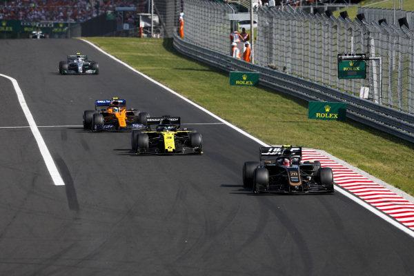 Kevin Magnussen, Haas VF-19, leads Daniel Ricciardo, Renault R.S.19, Lando Norris, McLaren MCL34, and Valtteri Bottas, Mercedes AMG W10