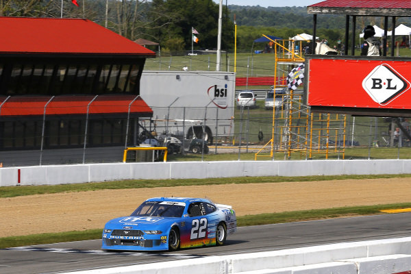 #22: Austin Cindric, Team Penske, Ford Mustang PPG drives under the checkered flag to win