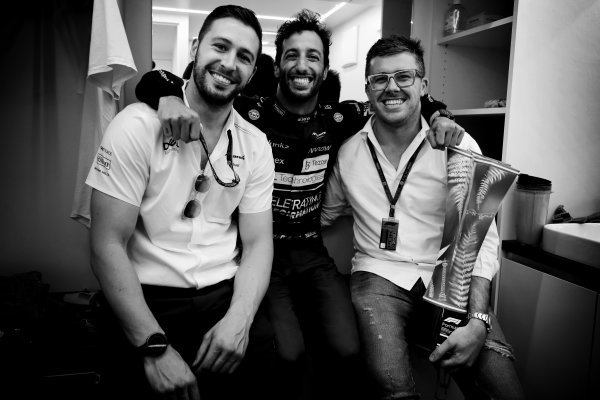 Daniel Ricciardo, McLaren, 1st position, celebrates with team mates after the race