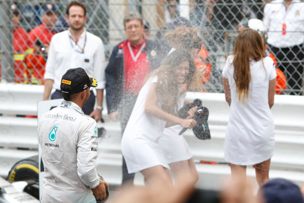 Monte Carlo, Monaco. Sunday 25 May 2014. Lewis Hamilton, Mercedes AMG, 2nd Position, hoses down some Grid Girls with Champagne. World Copyright: Andrew Ferraro/LAT Photographic. ref: Digital Image _FER7139