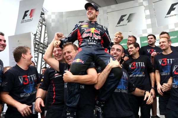 Interlagos, Sao Paulo, Brazil. Sunday 25th November 2012. Sebastian Vettel, Red Bull Racing, 2012 F1 World Champion, celebrates with his team. World Copyright:Andy Hone/LAT Photographic ref: Digital Image HONZ3866