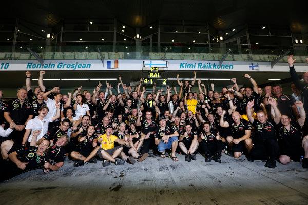 Yas Marina Circuit, Abu Dhabi, United Arab Emirates Sunday 4th November 2012. Kimi Raikkonen, Lotus GP celebrates winning the 2012 Abu Dhabi grand prix with his team. World Copyright:Andrew Ferraro/  ref: Digital Image _79P4097