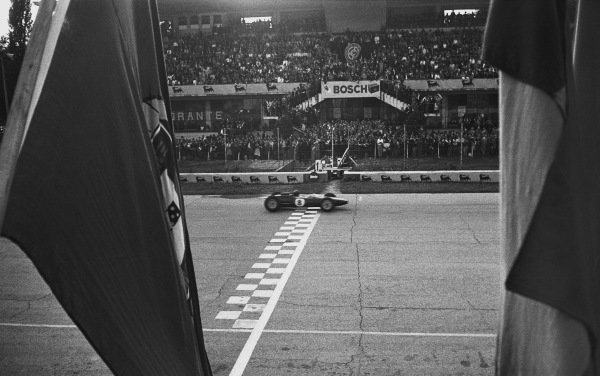 Monza, Italy. 6th - 8th September 1963.  Jim Clark (Lotus 25 Climax),1st position, crosses the finishing line clinching the drivers and constructors World Championship titles, action. World Copyright: LAT Photographic.  Ref: L63 - 282 - 27