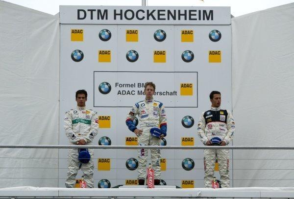 Podium, Sebastian Vettel (GER), Eifelland Racing (1st, center), Timo Lienemann (GER), Mücke Motorsport (2nd, left), and Filip Salaquarda (CZE), Sonax I.S.R-Charouz (3rd, right). Formula BMW ADAC Championship, Rd 19&20, Hockenheimring, Germany. 05 October 2003. DIGITAL IMAGE