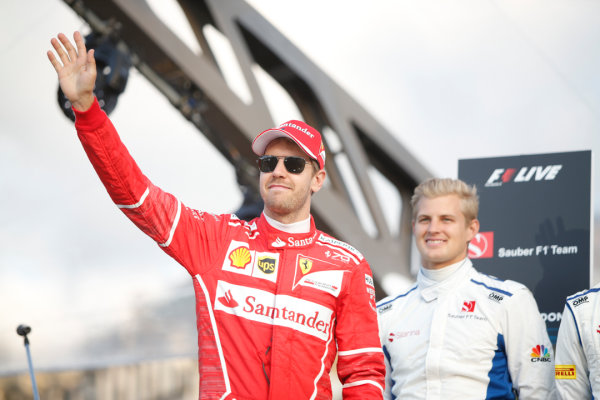 London, United Kingdom.  Wednesday 12 July 2017. Sebastian Vettel, Ferrari, and Marcus Ericsson, Sauber. World Copyright: Joe Portlock/LAT Images  ref: Digital Image _L5R8724