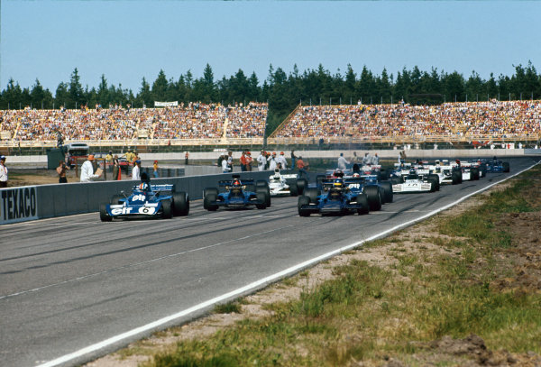 1973 Swedish Grand Prix.  Anderstorp, Sweden. 17 June 1973.  Ronnie Peterson, (Lotus 72D-Ford), 2nd position, leads Franois Cevert (Tyrrell 006-Ford), 3rd position and Emerson Fittipaldi (Lotus 72D-Ford), retired, at the start.  Ref: 73SWE86. World Copyright: LAT Photographic.