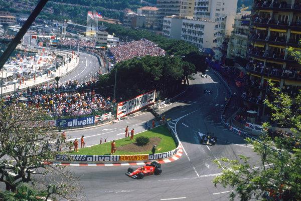 1986 Monaco Grand Prix.  Monte Carlo, Monaco. 8th - 11th May 1986.  Michel Alboreto (Ferrari F186), retired, leads Ayrton Senna (Lotus 98T-Renault), 3rd position, action. World Copyright: LAT Photographic.  Ref:  86MON01.
