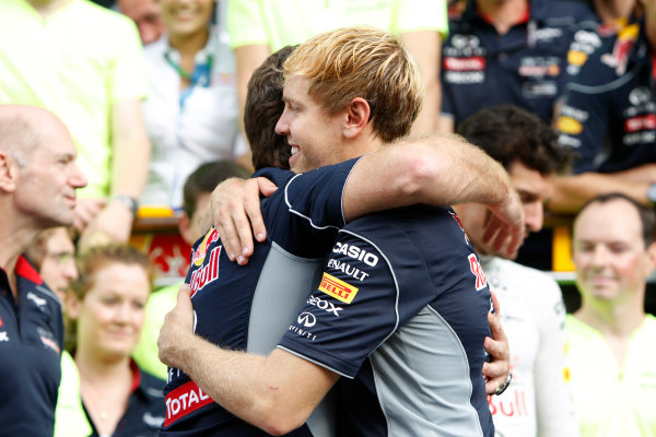 Autodromo Nazionale di Monza, Monza, Italy. 8th September 2013. Sebastian Vettel, Red Bull Racing., 1st position, is congratulated by Christian Horner, Team Principal, Red Bull Racing. World Copyright: Glenn Dunbar/LAT Photographic. ref: Digital Image _G7C9063